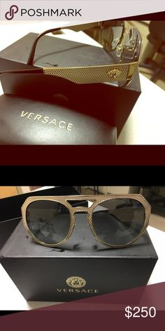 Gold Versace Sunglasses. Unisex Dark grey lenses New never worn. Dark grey lenses with Versace medusa logo on arms. Comes with box, case, dust cloth and authenticity card. Versace Accessories Sunglasses