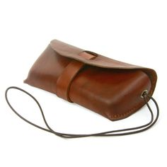 A leather case to keep your glasses protected and secure, featuring a multi-functional leather croakie for hanging either the case or your glasses around your neck. Designed by Casey Neefus. - 4/5oz H