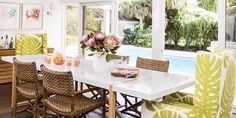 Beach House Decor Ideas - love the different textures and  the 2 upholstered dining chairs add such a pop of color