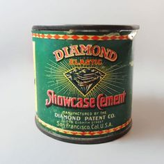 Vintage Diamond Elastic Showcase Cement metal tin.Net wt. 1 ounce (28.3 grams). Never opened. Contents not for use.Metal advertsing tin with paper label  FOR SALE