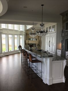 The chandeliers add sophistication to this elegant Plain & Fancy white kitchen in a newly constructed home along the coast. Gorgeous views from where ever you sit! Coffee Table Books, New Construction, Chandeliers, Your Design, Kitchen Design, Kitchens, Coast, Fancy, Elegant
