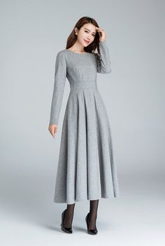 This grey wool dress open by back ziper, samller round collar. The winter dress is a fit and flare dress, it has no pleated in the waist. The wool dress has polyester lining, it will be comfortable when wear. Details: * Made from grey wool * Big Round neckline * back zip closure *party