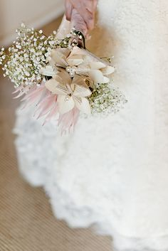 babys breath wedding bouquet with handmade paper flowers and a protea. So pretty! http://www.weddingchicks.com/2013/09/30/vintage-pink-and-white-wedding/