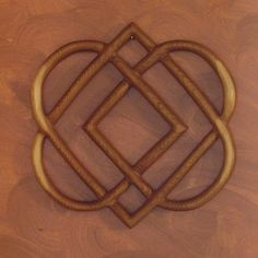 Celtic Knot of Four HeartsFamily Love Knot Wood by signsofspirit