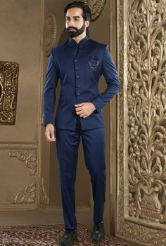 Terry Rayon Jodhpuri Suit in Navy Blue This Readymade attire is Enhanced with Buttons and is Crafted in Chinese Collar Neck and Full Sleeve Available with a Terry Rayon Pant in Navy Blue Do note Brooc - Indian Wedding Suits Men, Indian Groom Wear, Wedding Dress Men, Wedding Men, Indian Men Fashion, Mens Fashion Suits, Mens Suits, Reception Suits, Prince Suit