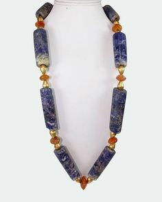 A very fine necklace featuring superb large lapis lazuli cylindrical beads from the Chavin culture of Peru, together with ancient Roman carnelian beads and anti