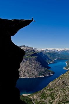 Trolltunga (Troll's Tongue) above Skjeggedal in Odda, Norway (by Dag Endre Opedal) **See the person sitting on the ledge? Odda Norway, Oh The Places You'll Go, Places To Visit, Beautiful World, Beautiful Places, Amazing Places, Wonders Of The World, Adventure Travel, The Good Place