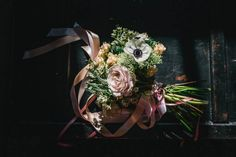 An elegant, ribboned bouquet with hints of pink | Image by Paul Santos Photography