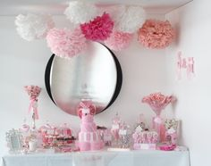 Pink Tissue Pom Poms and pink sugar.   You can buy them almost ready (Martha Steward pink decor) or entirely do it yourself, plenty of videos out there. It is a refreshing idea to suspend them from the ceiling and make any space feel fun.