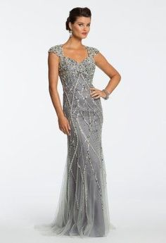 This platinum grey colored evening gown has a lot of beading and embellishments…