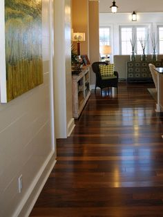Distressed laminatnt hard wood floors - they are more durable - softer on the foot - and more affordable too