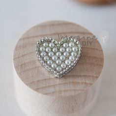 Silver heart shaped embellishment with pearl details. Heart shaped decoration for DIY wedding stationery and invitations. Paper craft supplies, Romantic