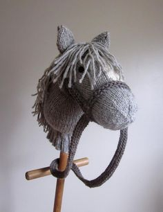 """For all the little knights and princesses... knit them a best friend to ride and play with! When you are done, hand the shiny new mount to your brave rider, and watch proudly for their exploits.ERRATUM:""""Head Turn"""" (page 2) - Row 1 (WS) should read: Rm, k1-tbl, p9, k2, p3, p2tog, p1. Turn.SizingLength of head (back of head to nose): 25 cm (10 in) approx.Height (base of neck to tip of ears): 32 cm (12 ½ in) approx.Total height depends on length of stick; approx. 110 cm high (44 in) following…"""