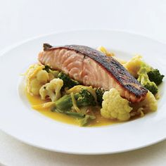 "Salmon with Gingery Vegetables and Tumeric. Alternative-health experts like Dr. Andrew Weil are lauding the ""anti-inflammatory"" diet, claiming that vegetables like broccoli, spices like turmeric and oily fish like salmon can ward off disease. This dish by F's Marcia Kiesel should make Dr. Weil very happy."