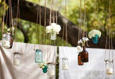Great way to hang mason jars and use them as a photobooth backdrop, or just to decorate your reception