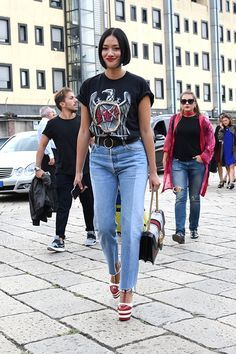 Milan Fashion Week Street Style | London buyer Tiffany Hsu rocked some stunning red and white Gucci platforms that put a well-heeled spin on her pretty casual jeans and tee getup.