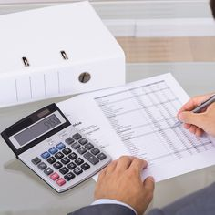 Photo about Accountant calculating finances. Over the shoulder view. Image of bookkeeping, income, businessman - 46359001 Essay Contests, College Essay, Car Finance, Earn Money From Home, Window Cleaner, Starting A Business, Accounting, Investing, Stock Photos