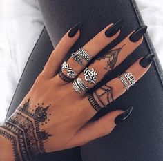 Black nails , henna and silver rings