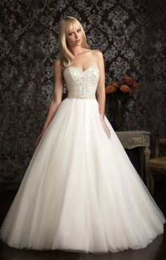 Allure Bridals 9006 is sweet and formal. This ball gown features a fitted bodice with a sweetheart neck line and low scooped open back, fully detailed in silver and iridescent sequins and stones. The crinoline skirt is high waisted and features a full length train that will slow beautifully down the isle.