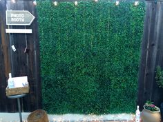 Fake grass squares from the $.99 Only store make a great/inexpensive photo backdrop!  Make a sign and hang an old digital camera and maybe a mini video camera so guests can leave you a video message. Upload all photos/videos to a Facebook page created in advance.