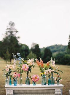 rustic florals in mismatched vases // photo by Tec Petaja, design + florals by Cedarwood Weddings // View more: http://ruffledblog.com/elegant-nashville-wedding/