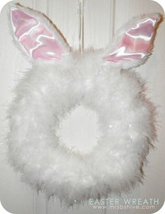 DIY Easter Bunny Wreath How-To ~ so Stinkin' Cute...  made using a Styrofoam circle, Bunny ears headband and Two 6 foot boas