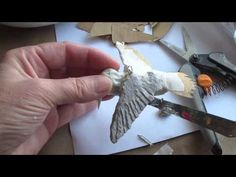 http://UltimatePaperMache.com/hummingbird    This is a fast project - easy enough so you could make a lot of them if you wanted to fill up your Christmas tree.  The body is made with a pattern, which you can find on her website, and the aluminum foil armatu...