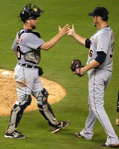 Bryan Holaday and Joe Nathan celebrate, 07/11/2014