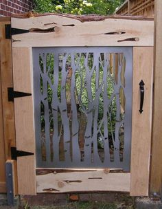 Image result for light wood gates with wrought iron decor