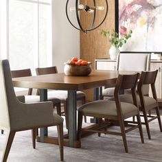 Curator dining table is the perfect combination of figured walnut veneers on top and metal for any dining room. Table goes from 84