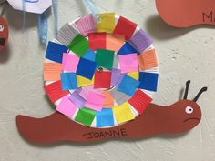 Paper plate snails using origami squares