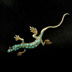 This tiny lizard brooch is typical of the type of jewelry which might have been shown at the Centennial Exhibition in Philadelphia which celebrated