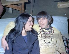 Singer/Songwriter Neil Young of the group Buffalo Springfield poses for a portrait with a woman at Gold Star Recording Studios in 1966 in Los Angeles, California.