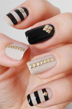 Fall nails with black stripes and golden ornaments