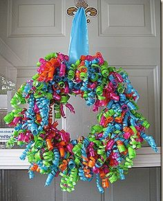"DIY Curly Ribbon Wreath-  I am going to make this with white and blue ribbon and add snow flakes for a ""winter"" look."