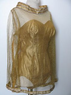 Vintage gold lurex swimsuit with matching net cover-up.