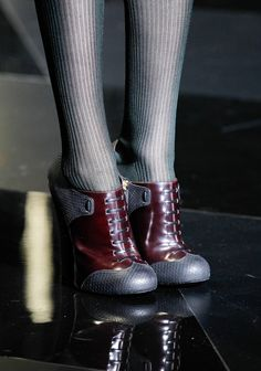 Louis Vuitton Fall 2011 ankle boots that are the right height up the ankle, and the tights are a great pairing