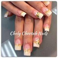 Chely Cheetah Nails. Acrylic Nails. White tip rockstar nails. Flower nail art.