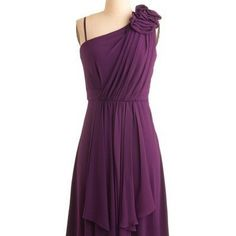 What an awesome color. The shoulder detail and the ruching make this dress super cute.