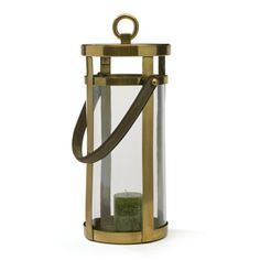"""Brushed Finish Wellington Lantern Wellington Lantern will sure to be noticed by your guests as you welcome them to your home.It has  handle that allows ease in holding.It will sure to give amazing look to your home.It is crafted with glass, brass with leather handle and have brushed finish. 9"""" Dia x 19"""" HMaterials: Glass, Brass with Leather HandleFinish: Brushed"""