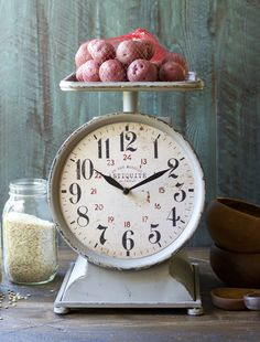 This unique Grocery Scale Clock adds a lovely Farmhouse feel to any kitchen! Set on your counter for a conversation piece!  Follow Gin Creek Kitchen on Facebook