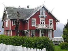 Traditional Norwegian Houses  | red house with traditional Norwegian wood work - Balestrand, NO