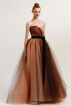 Carolina Herrera peach, beige, and brown strapless tulle gown with black grosgrain belt and bow