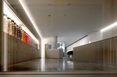brightly hued garments are displayed within recessed bands formed into the minimalist concrete surfaces of this showroom in milan, italy. Tadao Ando, Showroom, Milan, Stairs, Minimalist, Retail, Architecture, J3, Design