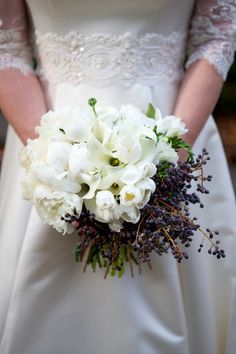 An elegant white bouquet with a splash of purple {Arden Photography}
