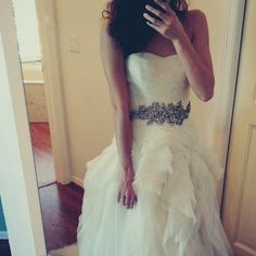 I LOVED Alli Trippy's wedding dress! It's a Vera Wang wedding dress with a frothy Skirt and a lace bodice!