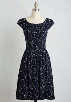 <p>This pocketed dress by hard-to-find British brand Emily and Fin will lift your spirits when you need it! Crafted from cotton and finessed with brilliant white shooting stars on its midnight-blue backdrop, this vintage-inspired frock makes you oh-so-merry.</p>