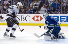 Goalie Cory Schneider #35 of the Vancouver Canucks stops Mike Richards #10 of the Los Angeles Kings