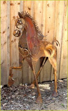 LooSee Art - Chainsaw and Metal Sculptures Arragon horse sculpture from found metals