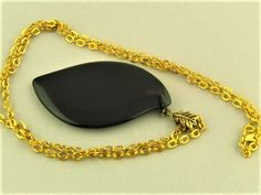 Large Black Opaque Leaf Shaped Glass Pendant with Gold Chain £12.50